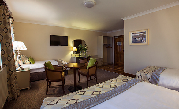 Large family room with double and two single beds at the Breffni Arms Hotel, Arva/