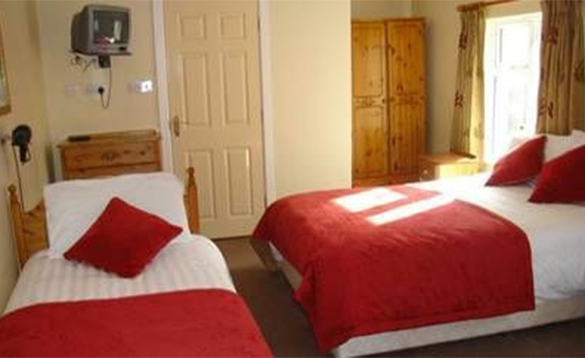 Bedroom with double and single bed at Church View B&B in Belturbet/