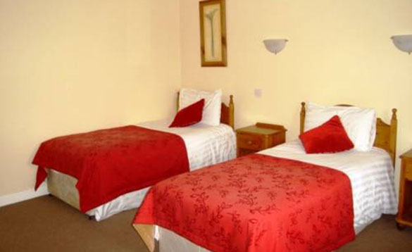 Bedroom with two single beds at Church View B&B, Belturbet/