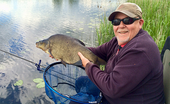 Angler holding a bream caught in Ireland/