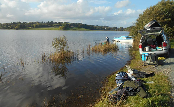 Angler fishing on a lakeshore in Co Cavan/