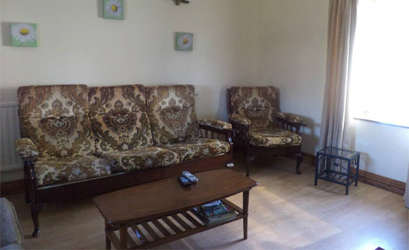 Sitting room in the farmhouse at Enaghan self-catering/