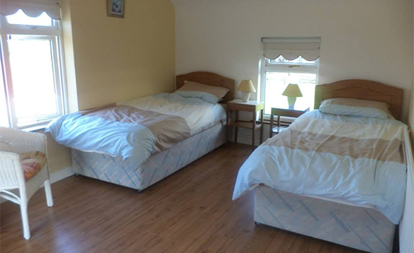 Room with two single beds in Enaghan Farm self-catering house/