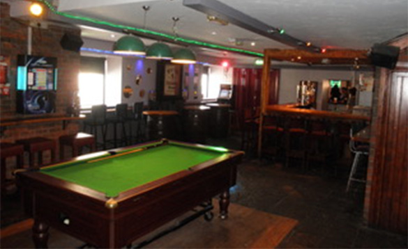 Bar area at Fitzpatricks Tavern with pool table/