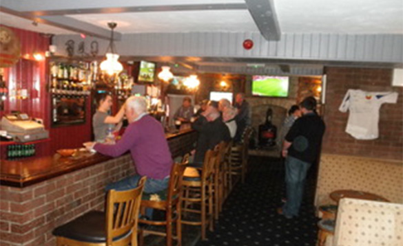 People enjoying drinks in the busy bar at Fitzpatrick's Tavern, Lough Gowna/
