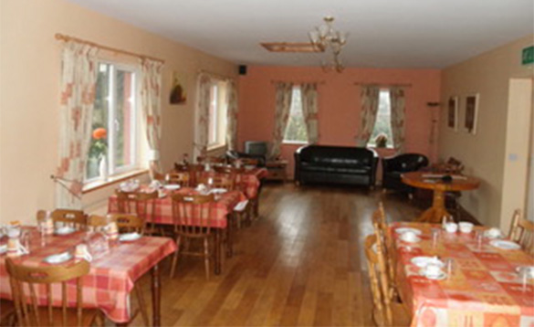 Dining room with tables set for breakfast at Fitzpatricks Tavern, Lough Gowna/