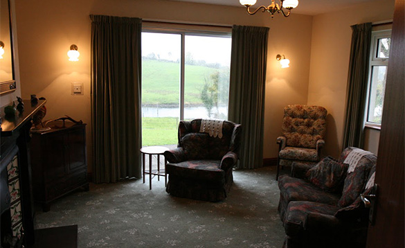 Lounge with patio doors and views of the River Erne /