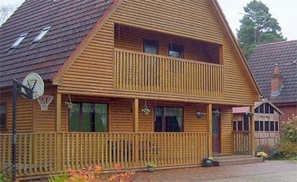 Large log cabin with veranda and balcony to second floor/