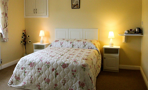 Bedroom with double bed at the Arches Farmhouse, Arva/