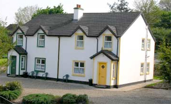 two storey white semi-detached houses, one with yellow door and one with green door/