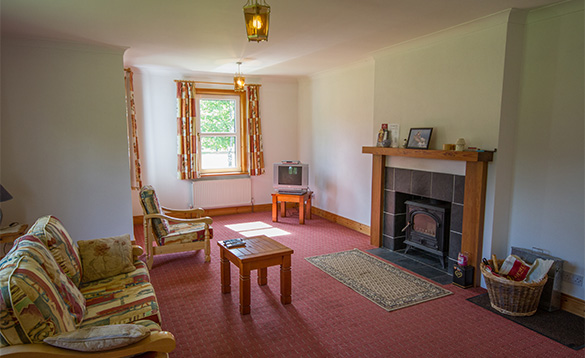 TV lounge with log burner at Tully's Lough Derg Holiday Homes/