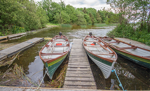 Boats moored against wooden jetties at Tully's Lough Derg Holiday Homes/