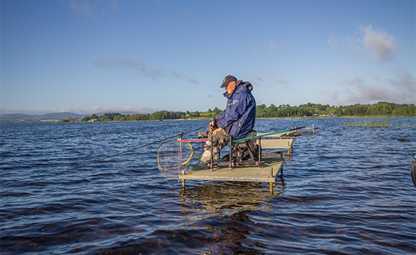 Angler fishing from a stand on Lough Derg/