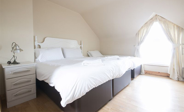 family hotel room with double and single bed with white bed linen/