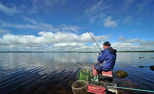Baz Smith angler fishing at the edge of Lough Derg in Portumna, Ireland/