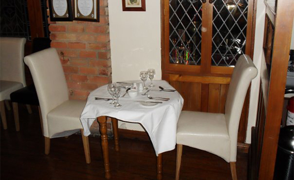 Dining table set for two people in the Kilbrackan Arms, Carrigallen/