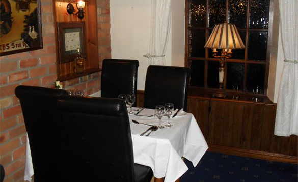 Dining table set for four people in the Kilbrackan Arms Hotel, Carrigallen/