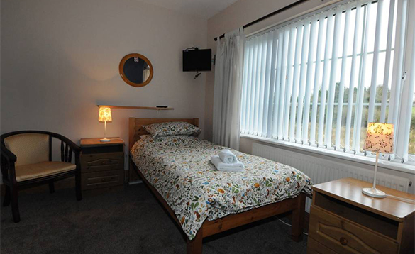 Bedroom with single bed at the Laurels B&B accommodation/
