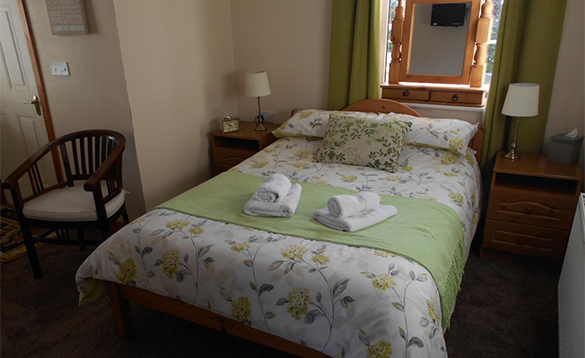 Bedroom with double bed at the Laurels B&B accommodation/