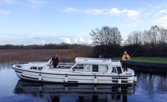 Angler fishing from a cruiser on Lough Ree, Ireland/