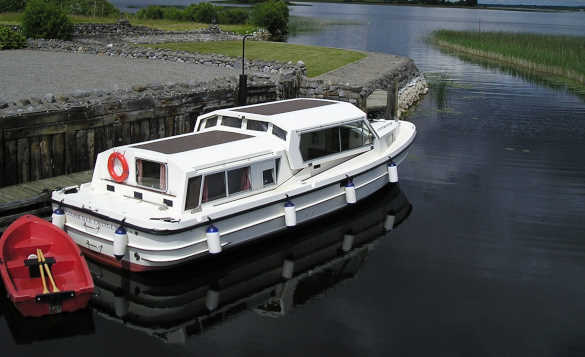 Cruiser moored against the jetty at Lough Ree Cruisers, Ireland/