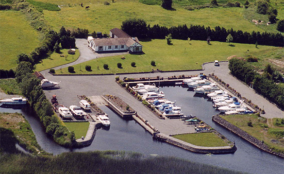 aerial view of cruisers moored in Lough Ree marina surrounded by fields/