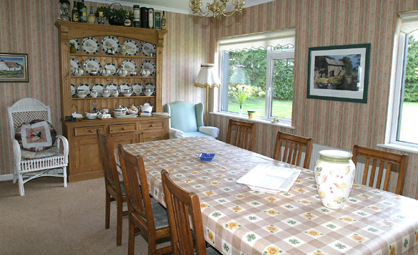 Dining room with large pine table and dresser/