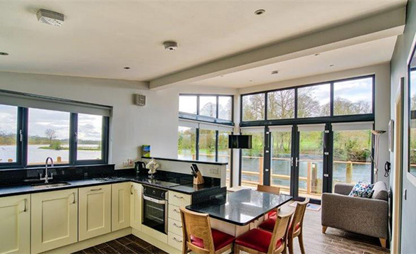 Kitchen/lounge area with views over Lough Erne at the Killyhevlin self-catering chalets/