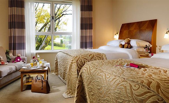 Luxurious bedroom with two double beds at the Killyhevlin Hotel/