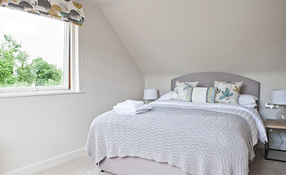Bedroom with double bed in a self-catering lodge at Finn Lough/