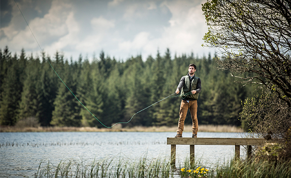 Angler fly fishing from a jetty at Finn Lough/