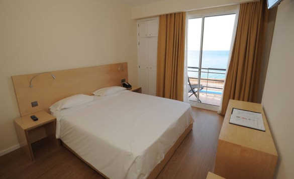 Double bedroom of Hotel do Mar with balcony and stunning sea views/