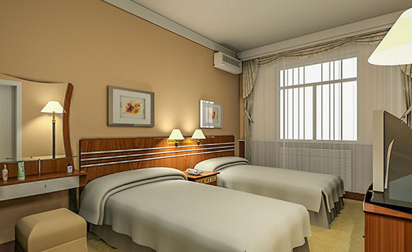 luxurious hotel room with peach coloured walls and twin beds with white bed linen/