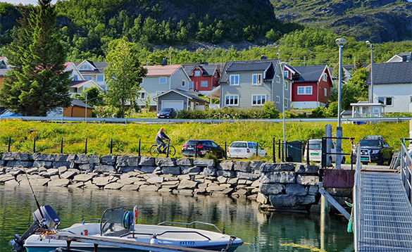 Fishing boat moored along a jetty in north Norway/