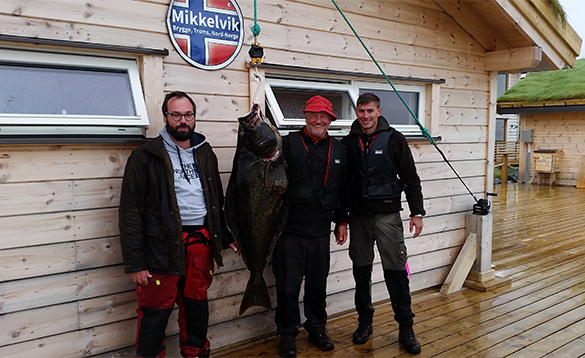 Three anglers with halibut caught in North Norway/