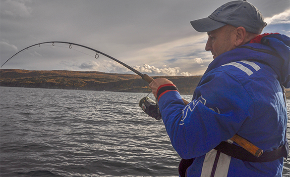 Angler fishing in north Norway/