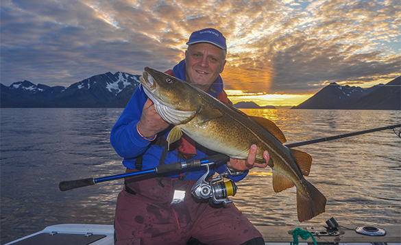 Angler holding a cod caught in north Norway/