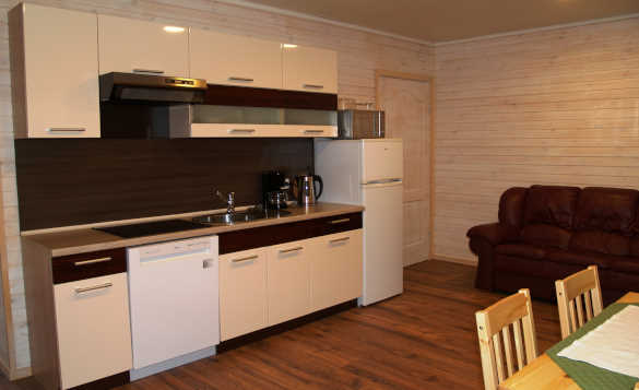 Lounge/kitchen area in the self-catering properties at Vikran Fishing Centre, Norway/