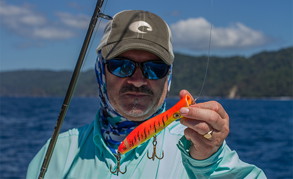 Angler holding a popper lure used for fishing in Panama/