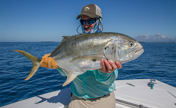 Angler holding a Jack Crevalle fish caught in Panama/