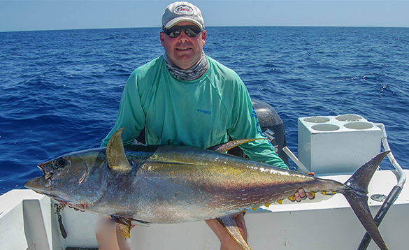 Angler sat on a boat with a yellow fin tuna caught in Panama/