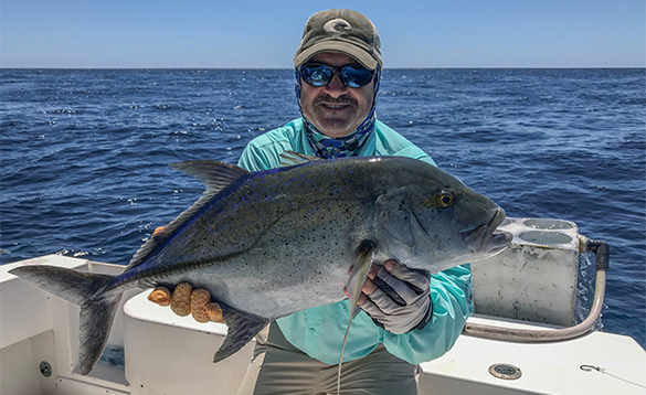 Angler with a blue trevally caught in Panama/