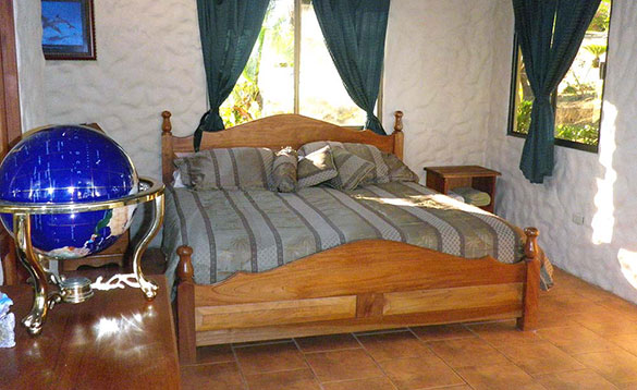 Bedroom with double bed at Paradise Fishing Lodge/