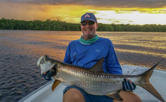 Man holding a 65lb tarpon caught in Puerto Rico/