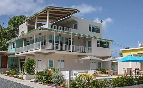Three storey white building with swimming pool in Puerto Rico/
