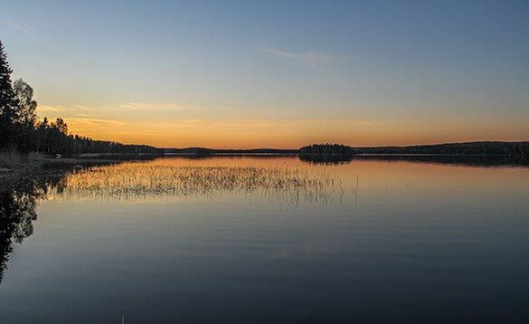 Sunrise reflected in a lake in Sweden/