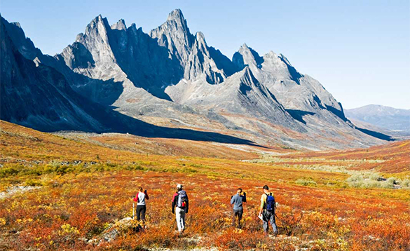 Group of hikers exploring Tombstone Territorial Park/