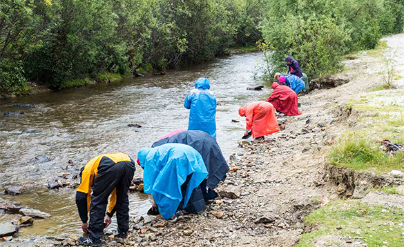 Group of people panning for gold in the Yukon/