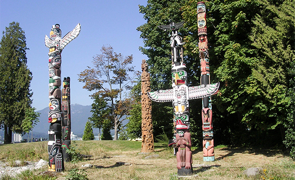 Humber of highly decorated totem poles/