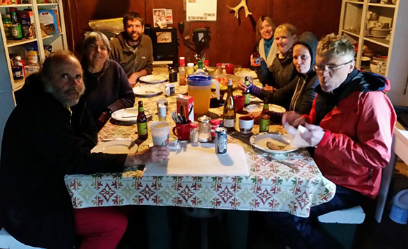 Group of people enjoying a meal in Sam's Camp in Alaska/